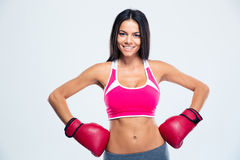 Smiling fitness woman in boxing gloves Royalty Free Stock Photography