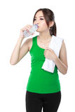 Smiling fitness woman drinking water Stock Photography