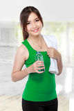 Smiling fitness woman drinking water Stock Image