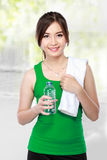 Smiling fitness woman drinking water Royalty Free Stock Image