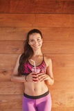 Smiling fitness woman with glass of fruit juice Royalty Free Stock Photo