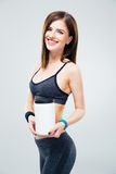 Smiling fitness woman holding jar of protein Stock Image