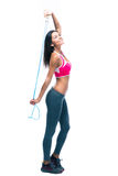Smiling fitness woman holding skipping rope Stock Photos