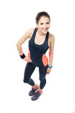 Smiling fitness woman posing over white background Stock Photo