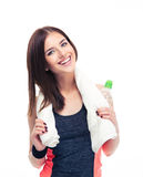 Smiling fitness woman with towel and bottle of water Stock Photo