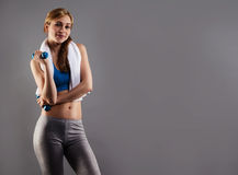 Smiling Fitness Woman With A White Towel And Dumbbells Stock Images