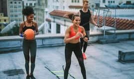Fitness people doing workout on rooftop stock images