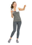 Smiling fitness young woman with bottle of water Royalty Free Stock Images