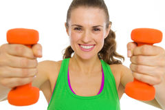 Smiling fitness young woman with dumbbells Stock Photography