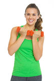Smiling fitness young woman with dumbbells Royalty Free Stock Image