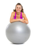 Smiling fitness young woman with fitness ball Stock Images