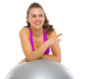 Smiling fitness young woman with fitness ball Stock Photos