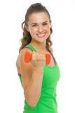 Smiling fitness young woman making exercise with dumbbells Stock Photo