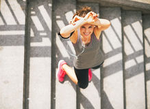 Smiling fitness young woman outdoors in the city Stock Photo