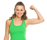 Smiling fitness young woman showing biceps. Isolated on white royalty free stock images