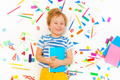 Smiling five years old boy holding textbook Royalty Free Stock Photography