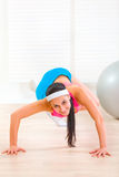 Smiling flexible girl doing gymnastics exercise Royalty Free Stock Images