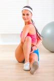 Smiling flexible girl making gymnastics exercise Royalty Free Stock Photo