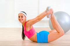 Smiling flexible girl making gymnastics exercise Stock Photo