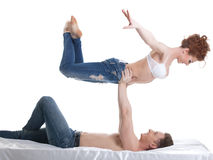 Smiling flexible lovers looking at each other Stock Photo