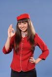 Smiling flight attendant Stock Photography