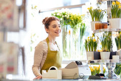 Smiling florist woman at flower shop cashbox Royalty Free Stock Photo