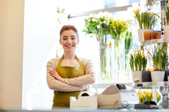 Smiling florist woman at flower shop cashbox Royalty Free Stock Image