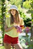 Smiling florist in yard gardening Royalty Free Stock Photos