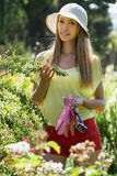 Smiling florist in yard gardening Royalty Free Stock Photo