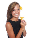 Smiling Flower Girl. A pretty, smiling young woman holding a yellow flower Royalty Free Stock Photo