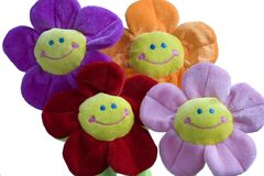 Smiling flower toys. On white background Royalty Free Stock Images