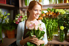 Smiling flower woman Stock Photography