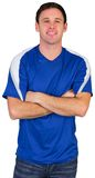 Smiling football fan in blue Stock Image