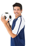 Smiling football player Stock Photo