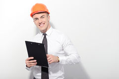 Smiling foreman holding folder on isolated Stock Photography