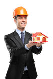 Smiling foreman holding a model house Stock Images