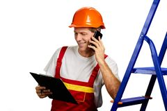 Smiling foreman talking on cell phone. stock photos