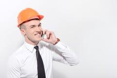 Smiling foreman talking per mobile phone Royalty Free Stock Photo