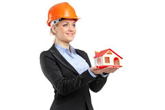 A smiling forewoman holding a model house Stock Photography