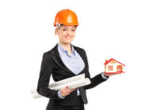 Smiling forewoman holding a model house Stock Photo