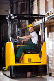 Smiling forklift driver Royalty Free Stock Photo
