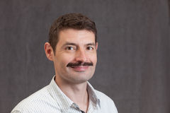 Smiling forties man with a mustache Stock Photo