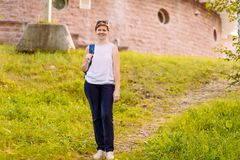 Smiling forty-year-old woman summer in full growth. Outdoors royalty free stock photos