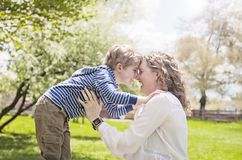 Happy Grandmother and grandson face to face in park Stock Photography