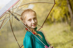 Smiling freckled girl posing with umbrella Stock Photos