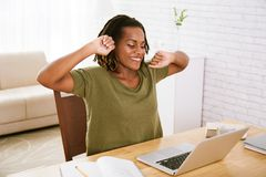 Stretching woman. Smiling freelancer stretching after long day of work Stock Photos