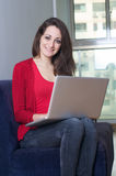 Smiling french girl with laptop Royalty Free Stock Image