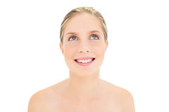Smiling fresh blonde woman looking up Royalty Free Stock Images
