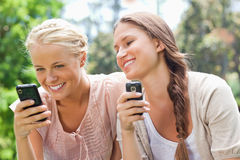 Smiling friend with cellphones Stock Photos