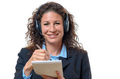 Smiling friendly businesswoman in a headset Royalty Free Stock Photo